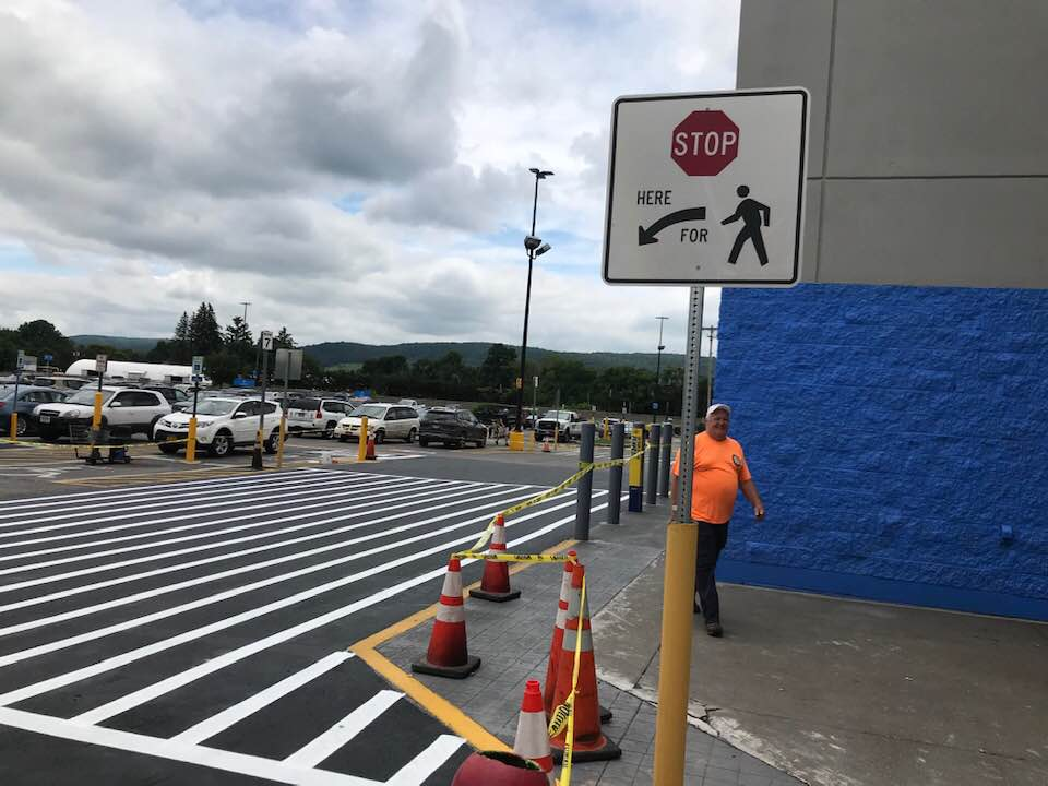 Parking lot patched and striped - Asphalt Maintenance by MJ Pelkey